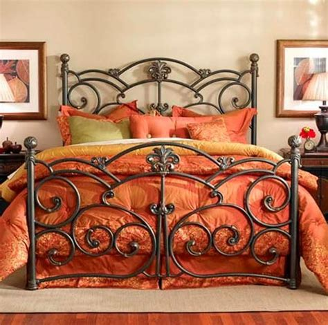 detailed wrought iron bed frame and orange bedspread