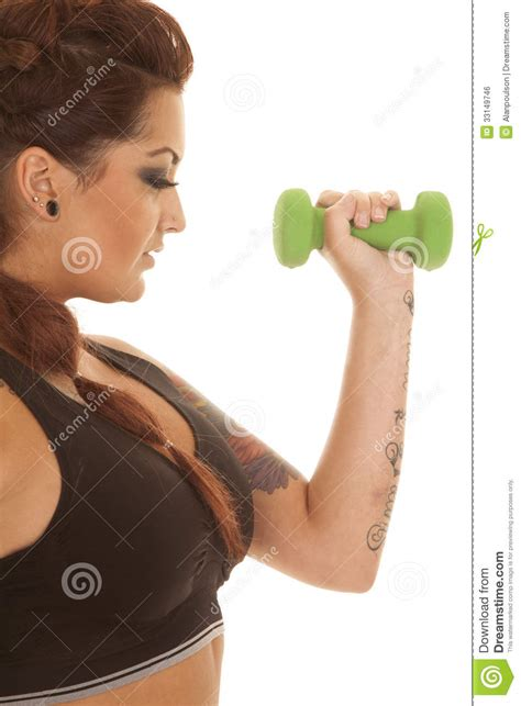 woman tattoos fitness green weight arm close royalty