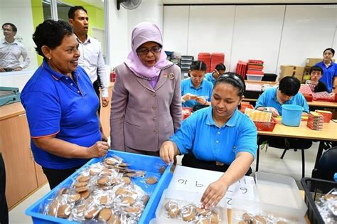 president halimah visits special  centre  adults