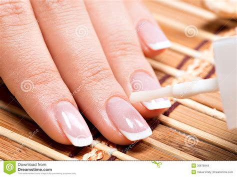 Woman In A Nail Salon Receiving Manicure Stock Image