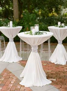 White, Pillar, Candles, And, Greenery, Atop, Cocktail, Tables