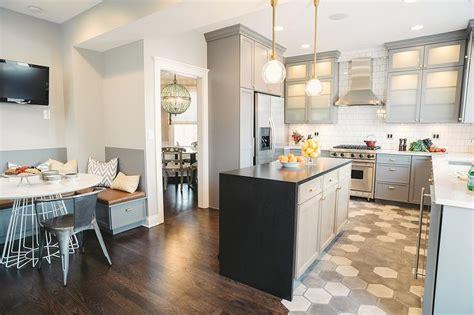 gray kitchen cabinets  white  concrete hex tiles