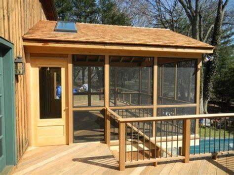 screen porch with ipe floor cedar posts ipe rail in