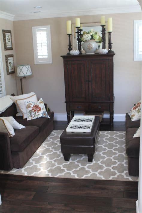 image result  dark brown floor grey sofa   dark
