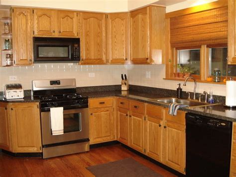 kitchen white wall paint with brown wooden oak cabinet