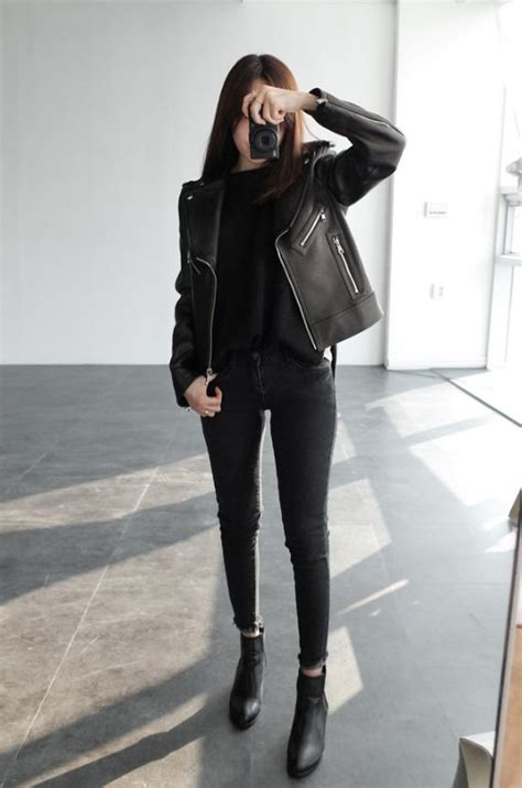 Picture Of jeans a top ankle boots and a leather jacket