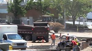 Double dump truck dumping a load of gravel - YouTube