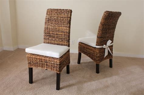 banana leaf and oak dining table chairs with cushion and
