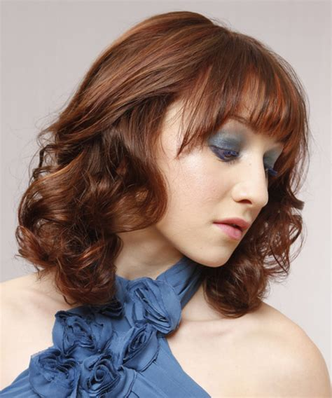 Auburn And Hairstyles by Medium Wavy Auburn Hairstyle With Layered Bangs