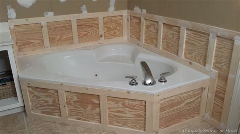 Installing Wainscoting Panels In Bathroom by Installing Wainscoting Around Bathtub In Master Bathroom