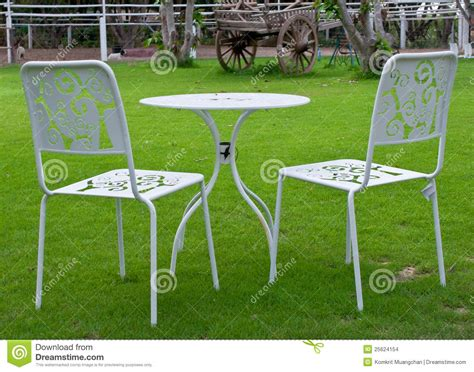 Lawn Table And Chairs by White Table And Chairs In Lawn Stock Images Image 25624154