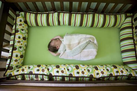 baby crib bumpers white noise machines could hurt babies hearing study
