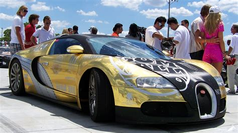 Now anyone can call our drug and drama helpline. Bugatti veyron covered in gold edition at gumball rally on ...