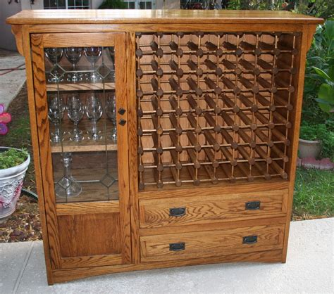 wine rack storage cabinet i converted an old tv cabinet into a wine rack it 39 ll hold