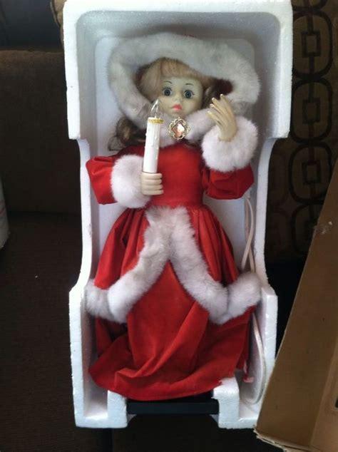 telco motion ette animated christmas caroler girl holiday