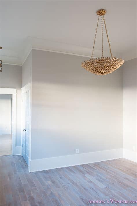 living room light gray walls grey gold chandelier black