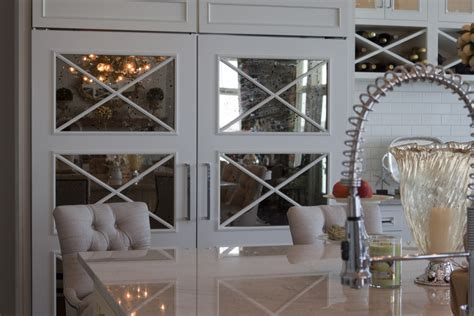 mirrored glass kitchen cabinets place the mirrored cabinet doors in your kitchen
