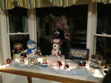 christmas window ideas for bay window decorating a bay window with snowmen