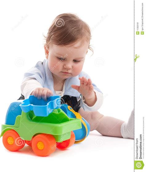 Portrait Of Adorable Baby Boy Playing With Toys Stock