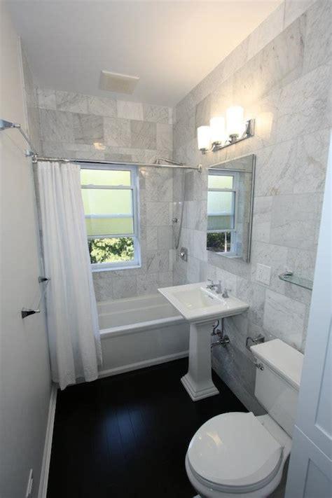 white bianco carrara marble transitional bathroom