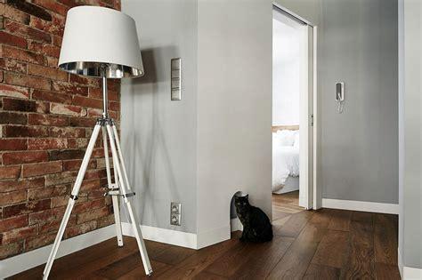 renovated krakow apartment showcases beauty  exposed