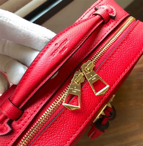 louis vuitton saintonge tassel handbag  red