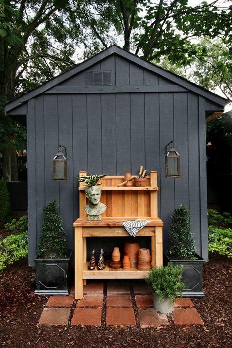 black garden shed  cedar potting bench backyard