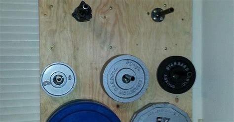 love stuff diy wall mounted weight plate storage garage pinterest trees plate storage