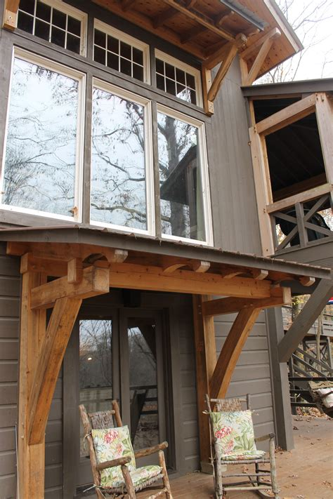 basement entry trimmed  handcut heavy timbers timber frame porch porch timber timber framing