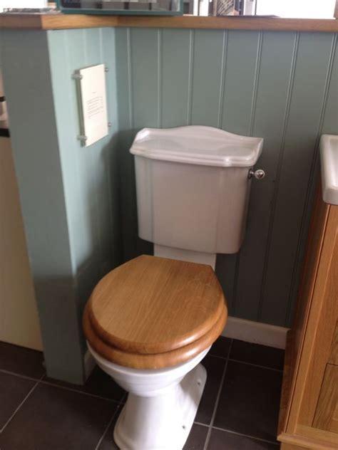 downstairs toilet dark floor tiles traditional style