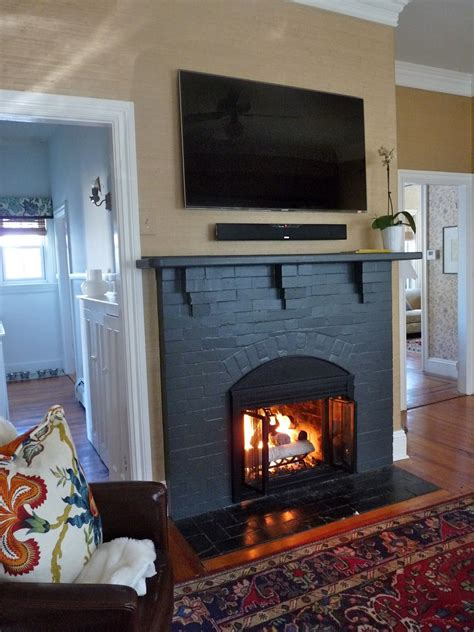 love the black fireplace living rooms painted brick
