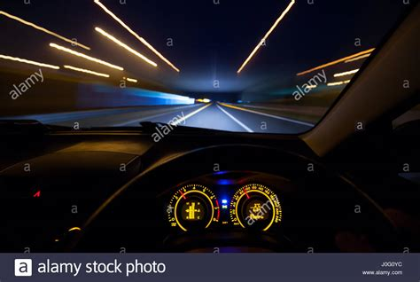 Driver View At Speeding Car Dashboard And Motorway At