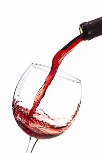 Red Wine Pouring Into Wineglass Splash Photograph by ...