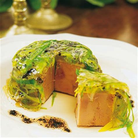 aspic cuisine hockey puck covered with jellied grass clippings and a