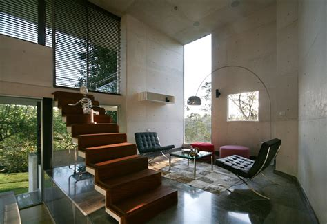 living room small and wooden staircases brick wall design briones house designed by rp arquitectos keribrownhomes