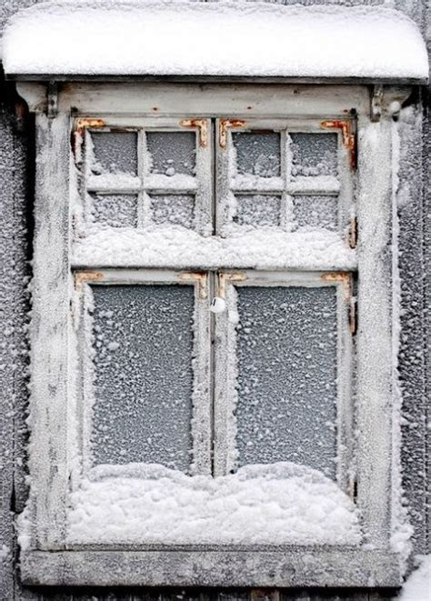 winter is coming frosted snowed window pane tap on