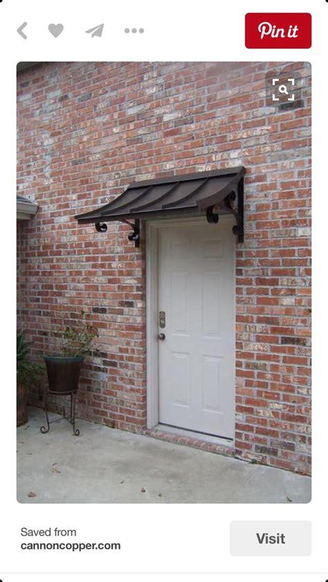 pin  jay guy  exterior door awnings metal awning copper awning front door awning