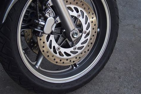 How To Fix A Front Brake Rubbing The Wheel On A Motorcycle