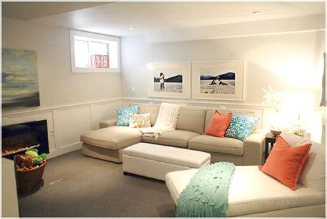 white sofa with colorful pillows basement apartment ideas with decor that has a white sofa