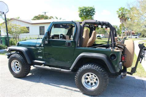 tan jeep wrangler 2 door 1999 jeep wrangler sport 2 door 4 0l green on tan