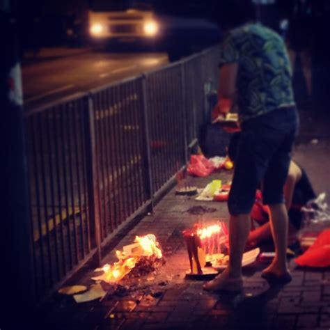 burnt offerings   street  yu lan hungry ghost festival hong kong   eyes
