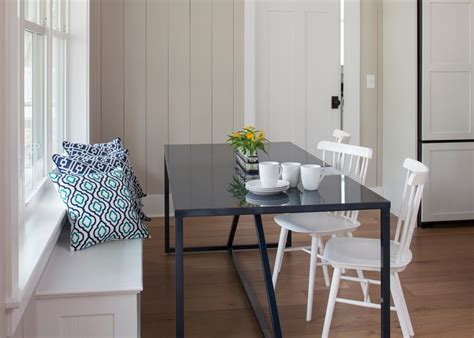 Cottage Breakfast Nook With White Banquette And Navy Table