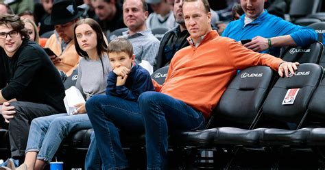 peyton mannings son steals dads spotlight  nba game