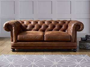 cara faux leather sofa living it up With faux leather sofa