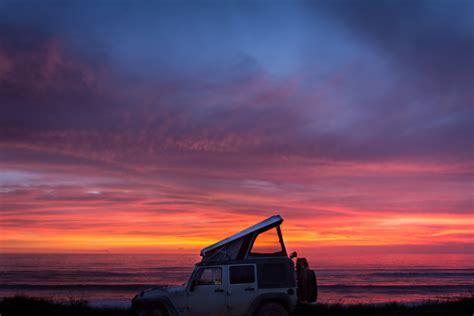 jeep beach sunset angola awaits the road chose me