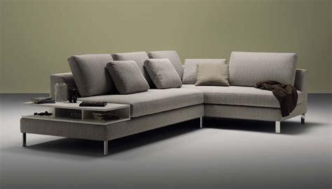 divano ad angolo  portariviste integrato design moderno
