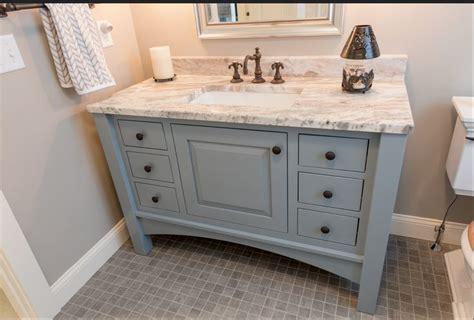 grey furniture vanity  arched valance  bath