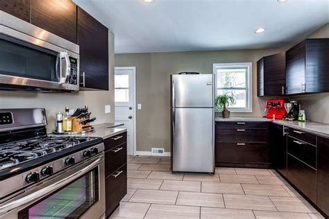 gray kitchen backsplash essential kitchen updates to make before selling your home 1319