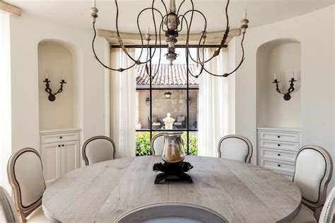 Round Mediterranean Dining Room with Arched Alcoves