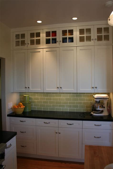 Glass Doors On Top Lighten The Bank Of Cabinets Without